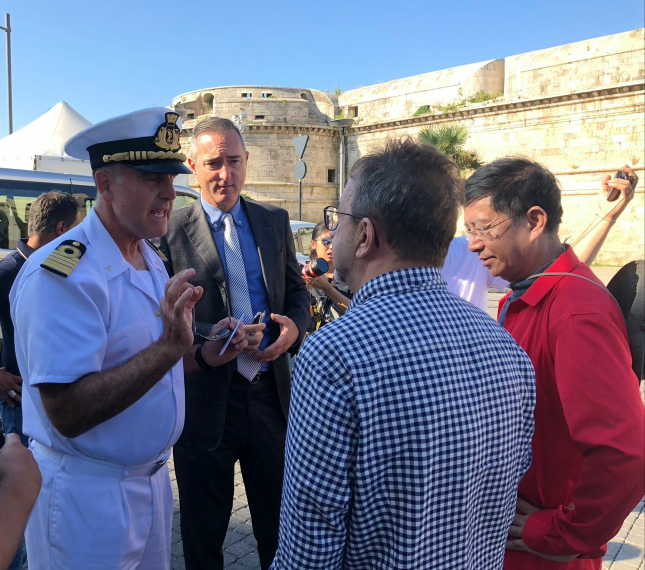 "Delegation of CCTV, Chinese TV, at the historic port of Civitavecchia for the shooting of ""From Xi'an to Rome"" (left to right: Captain Vincenzo Leone and Manger of the AdSP Malcom Morini)"