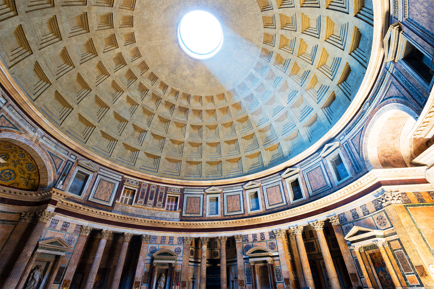 The striking perspective of the dome of the Pantheon with the light from the oculus