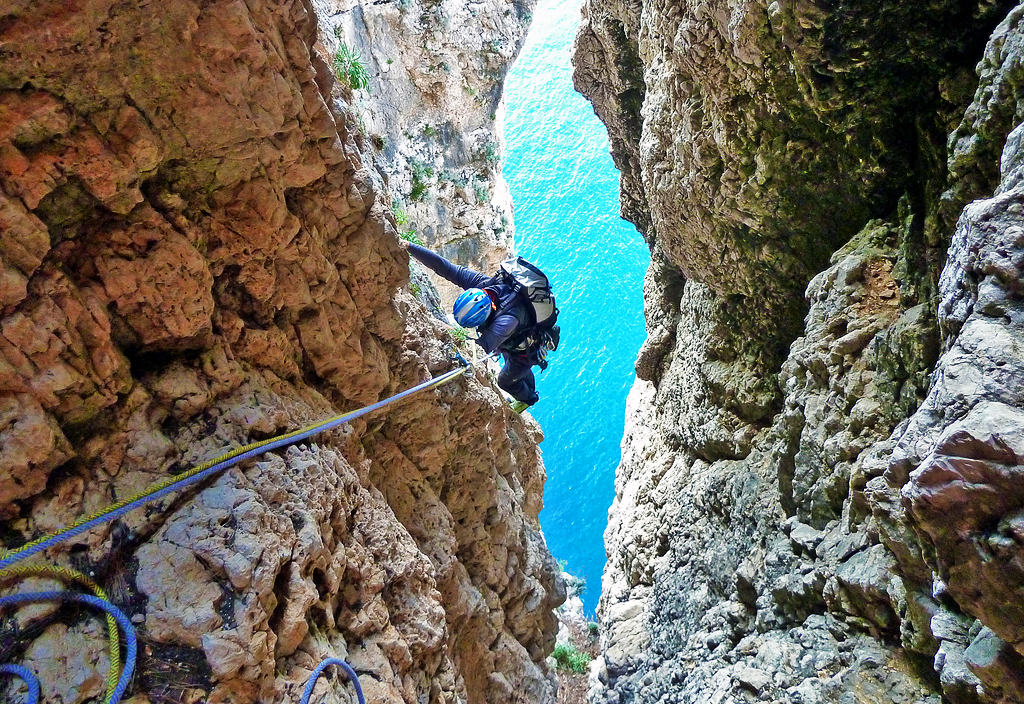 Free climbing on the rocky walls of the Split Mountain