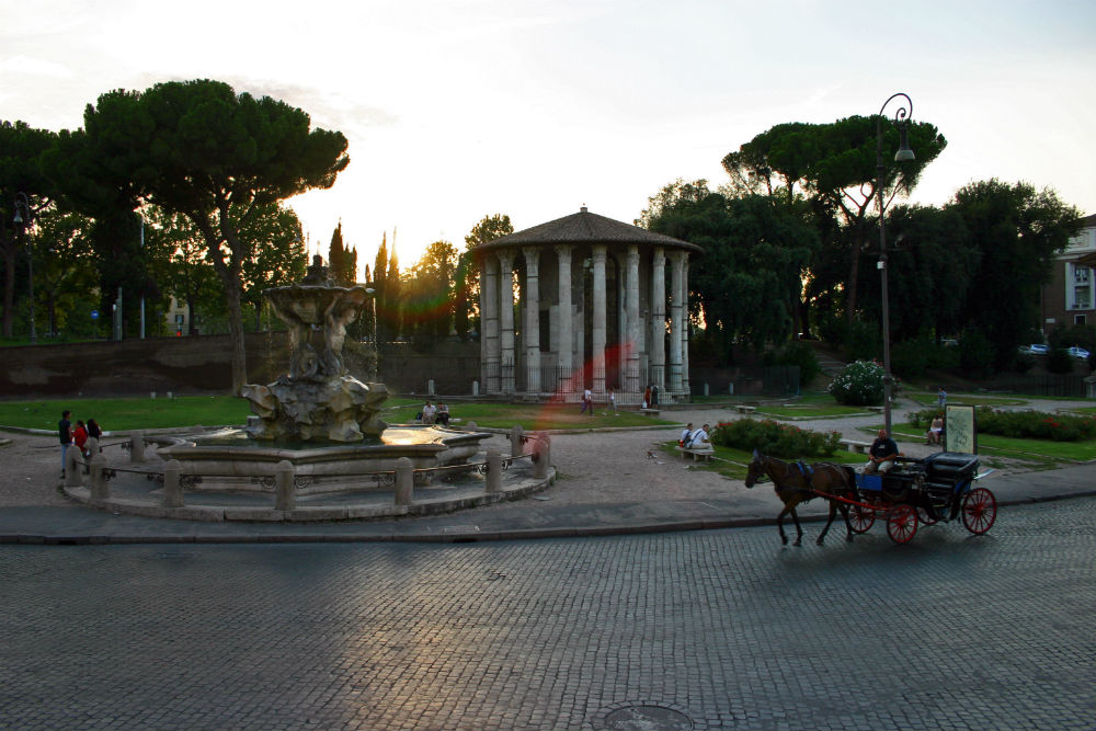 The beautiful square in front of Bocca della Verità with the fountain of the Tritons and the temple of Hercules